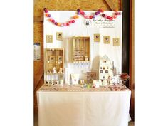 craft display: using one table with backdrop to display vertically. Excellent use of space