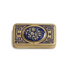 A JEWELLED GOLD AND ENAMEL SNUFF BOX WITH CONCEALED WATCH MOVEMENT apparently unmarked, Geneva, circa 1865  of rounded rectangular form, the cover with an oval lid enamelled in translucent blue and set with a rose diamond floral spray, concealing the white enamel dial with Roman numerals, the interior of the lid with a photograph, the ground enamelled with strapwork on an engraved ground, the base with a flowery cartouche engraved: David Sassoon,