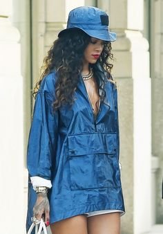 Rihanna wearing a blue rain pullover and a blue bucket hat