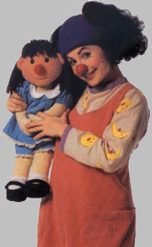 Lunette and molly a clown and her dolly on the big comfy couch!! I still have my Molly doll. She is my main lady still to this day!