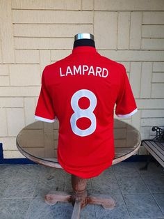 AWAY SHIRT AS WORN DURING WORLD CUP 2010 IN SOUTH AFRICA. Lampard's goal was the 500th England goal scored at Wembley. England Goals, Vintage Jerseys, Football Jerseys, Jersey Shirt, World Cup, South Africa, Classic, Stuff To Buy, Shirts