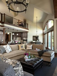 I like the colors used here, they go nicely with the wood accents. Nice couch color, nice deep blue accents and I LOVE the windows. House Rooms, House Styles, Sweet Home, Home And Living, Family Living Rooms, House, Interior Design, Home Decor, Home Deco