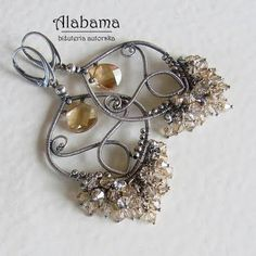 Fanaberia - biżuteria   No idea what language the site is, but amazing photos of wire wrapping
