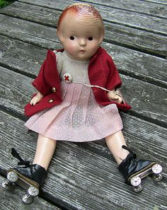 Unmarked doll in skates with Red Cross pin.