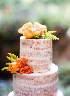 Colorful floral topped naked cake: http://www.stylemepretty.com/little-black-book-blog/2016/05/24/pretty-plates-two-piece-wedding-dress-tropical-styled-shoot/ | Photography: Audra Wrisley - http://audrawrisley.com/