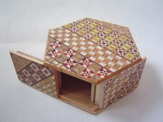 Japanese Puzzle box (Himitsu bako)- HEXAGON -Open by 6steps Yosegi. $63.00, via Etsy.