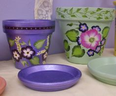 More flower pots painted by Joann, one of my students. She preparing for a local craft festival in November