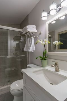 "Contemporary 3/4 Bathroom with Foremost White Gazette 24"" Framed Wall Mounted Mirror, Undermount Sink, limestone tile floors"