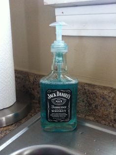 Jack Daniels soap dispenser. Not perfect, needs black paint or something around the top but still pretty awesome. It does the job