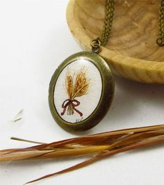 Savannah, check it out! Bundle of Wheat , boho hand painted locket by TuckooandMooCow