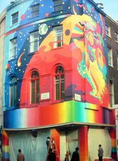 The Beatles' Apple Boutique in London with mural by Dutch psych-art collective known as The Fool.