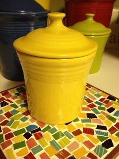 Forget the canisters ... look at the Fiesta mosaic trivet ! want to make one !