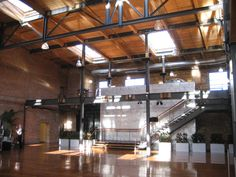 This is Bay 7 in the American Tobacco District of downtown Durham. It's a beautiful space that sits in a renovated warehouse district, but the surrounding area has the ballpark, the theater, and lots of cool restaurants. It's a huge space with a different feel. It's definitely more of a blank slate which is both exciting and scary...it's late so more to come!!