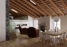 La ristrutturazione di un antico attico nel centro di Udine, con finestre per tetti e un caratteristico soffitto in legno