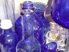 I repinned this from http://lorraine-syratt.suite101.com/collecting-antique-cobalt-blue-glass-apothecary-jars-and-bottles-a277889