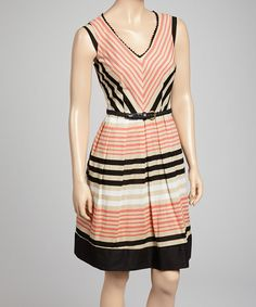 Decked out in stylish stripes and a classic chevron print, this dress is sure to impress. A sweetly scalloped neckline amps up the femme factor, while the braided belt contours curves to pretty perfection.