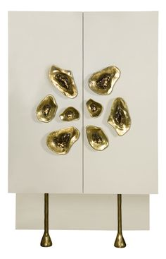 KELLY WEARSTLER | CRESCENT CABINET. Composed of parchment, mixed metals and cast pyrite in jewelry–like settings.