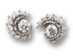 PAIR OF DIAMOND EARCLIPS, CIRCA Centering 2 round diamonds weighing and carats respectively, bordered by foliate swirls set with 20 marquise-shaped diamonds weighing approximately carats and 26 baguette diamonds weighing approximatel Diamond Earing, Diamond Studs, Diamond Jewelry, Diamond Solitaire Earrings, Diamond Knot, Platinum Jewelry, Modern Jewelry, Fine Jewelry, Contemporary Jewellery