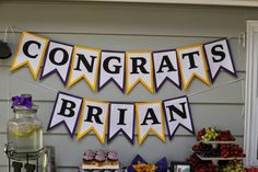 UW Graduation party food table. purple and gold party. banner made with silhouette cameo. @silhouettepins