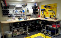 Customize your workspace with Wall Control's many pegboard colors. This is a great hobby workspace, color coded for dad and the kids. Thanks for the great customer submission John! Garage Tool Storage, Pegboard Organization, Shed Storage, Craft Storage, Organization Ideas, Reloading Room, Window Display Design, Shop Plans, Workbenches