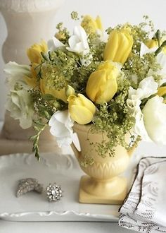 Spring time arrangements, Yellow Tulips bit of Ivy , white Crocus flowers, Are a Lovely setting.<3<3