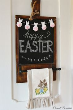 Cute Easter chalkboard with mini bunny bunting. Love the baker's twine pom pom tails! // cleanandscentsible.com