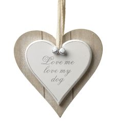 This sweet white wooden 'love me, love my dog' heart decoration is mounted on a contrasting natural coloured heart background, and would make a delightful gift idea for someone who loves their four legged friend!  The sign has a fabric loop so you can hang it easily within your home.   Size: 12 x 12 x 1cm  http://www.lancashiredogcompany.com/for-your-home/signs-and-sayings/love-me-love-my-dog-sign.html