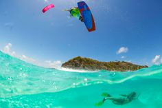 The 2016 North Kiteboarding Rebel kite and Gambler board over tropical waters. Kiteboarder jumping while girl dives under water. Kitesurfing, North Kiteboarding, Wakeboard, Big Waves, Great Shots, Water Sports, Diving, Rebel, Tropical