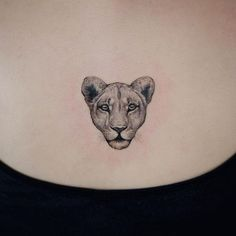 Small lioness tattoo