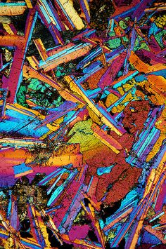 Thin rock section seen through the 10x objective of a Motic BA300 Polarizing microscope. Via JonDM.
