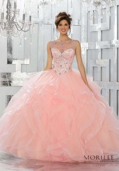 Beautiful Blush Quinceañera Ballgown featuring a Fully Beaded Bodice with Jewel Illusion Neckline and a Breathtaking Flounced Tulle Skirt Accented with Horsehair Trim. Matching Stole included. Colors available: Blush, Navy, Black Cherry, White. Princess Ball Gown Sweet 15 Dress by Vizcaya | Morilee by Madeline Gardner. Style 89141.