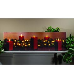 This lighted canvas is decorated for the holidays with five lit candles, and a lit pine garland, on top of a mantel. Dimensions: 10X 34 X 1 inches Stretched c