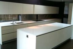 White Hacker Kitchen with Silestone Worktops and Miele Appliances