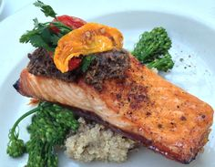 New Roasted Pacific Salmon Entree  with mediterranean tapenade, quinoa and broccolini