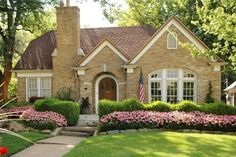 Tudor Revival - love this quaint home. Would look gorgeous w/ ivy surrounding the arched window.