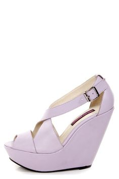 Check it out from Lulus.com! The Mojo Moxy Creamy Lilac Peep Toe Platform Wedges are the stuff that dreams are made of! Smooth lavender leather forms a pretty peep toe vamp, with crisscrossing straps above that fasten at the heel cup with a silver buckle (and hidden elastic). Wrapped platform builds from 1.5