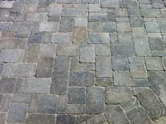 Three piece random pattern Dublin Cobble driveway with detail cuts around existing pull boxes and drains.  Project Length: 10 Days  Cost: $19k Materials, Install  Materials: Pavers - Dublin Cobble by Belgard, Victoria / Sienna color