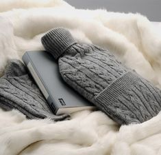 Nicky Dobree Collection. Throws, cashmere hot water bottles and gorgeous cashmere socks. So toasty.
