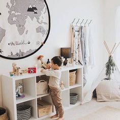 Love the white colour scheme in this picture. The map rug is so cute and I want one of those little teepees for the studio! OYOY The World Rug
