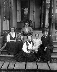 First Lady Frances Folsom Cleveland and Grover Cleveland, 22nd and 24th President of the United States posing on the porch with four of their five children.