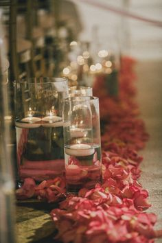 Love these floating candles and petals as aisle markers! {Villetto Photography}