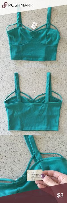 Teal crop top Super cute teal crop top! Still has the tags attached. Tops Crop Tops