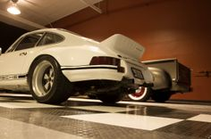 #RaceDeck garage flooring with some sweet rides #Porsche #RSR #49Chevy #RaceDeckSpeedGarage http://www.racedeck.com