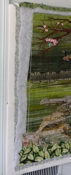 Linda's Landscapes: Coming into Home Stretch She shows a nice tip for finding true vertical to square up your quilt: Use a plumb bob i.e. tack string in corner and hang clip on other end. voila! straight edge!