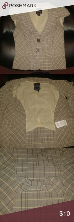 Pretty Top Short sleeve , brown w/ dark brown , green , and yellow pattern , has 2 fake pockets , brown buttons , the cutest bow on the back , yellow on the inside , might want to wash it , worn once , tight fitting | price negotiable My Michelle Tops