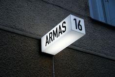 Armas (signage) — Aleksi Hautamäki, black and white, blade, internal illumination Signage Display, Retail Signage, Wayfinding Signage, Signage Design, Retail Branding, Environmental Graphic Design, Environmental Graphics, Sign Board Design, Exterior Signage