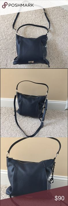 Michael Kors cross body bag Authentic beautiful pebbled blue leather Michael Kors handbag can be used as shoulder bag or worn cross body.  This spacious bag has multiple cell phone pockets, zippered inside pocket and a large open area to carry many essentials.  It also features two unique outside zipper pockets to carry anything you need quick access to.  The bag apx measurements are 11 inches wide, 12 inches tall and 6 inches deep.  There is a shoulder strap as well as a cross body strap…