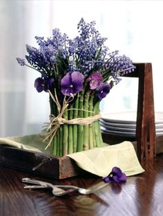 Asparagus Floral Arrangement ~ Create a fresh spring bouquet by bundling asparagus stalks around a vase, and tie with twine or ribbon. Place the bouquet in a tray or dish to form an easy centerpiece. Add to the table decor with a bundle of four asparagus stalks at each place setting to hold a name card. http://www.tipsfromtown.com/2013/03/23/diy-easter-centerpieces-wo-325/#.Uv9H5kJdVe8