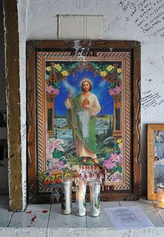 Candles lit to honor San Judas Tadeo in a small chapel located on the highway south of Nuevo Laredo, Mexico