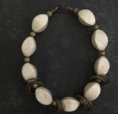 """Handmade statement beaded necklaces Organic Garlic skin that has been cerefully set incased in a mold to create a beautiful and unique opalscent bead with antique brass findings. 19.5"""" long"""